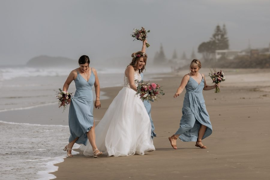 Bridesmaids on Waihi Beach in blue dresses