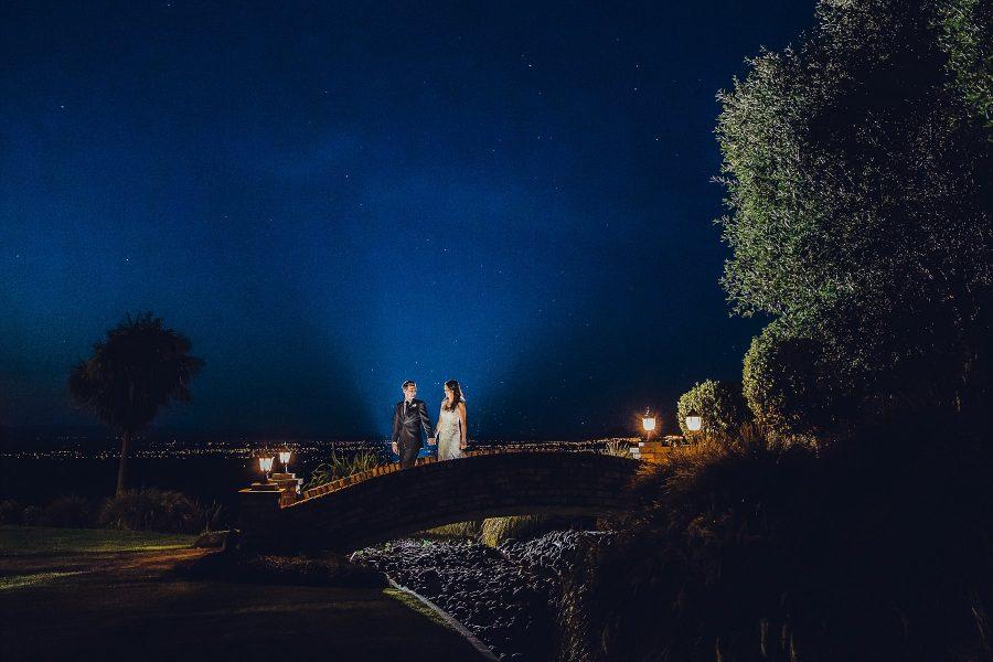 Creative wedding night image on bridge