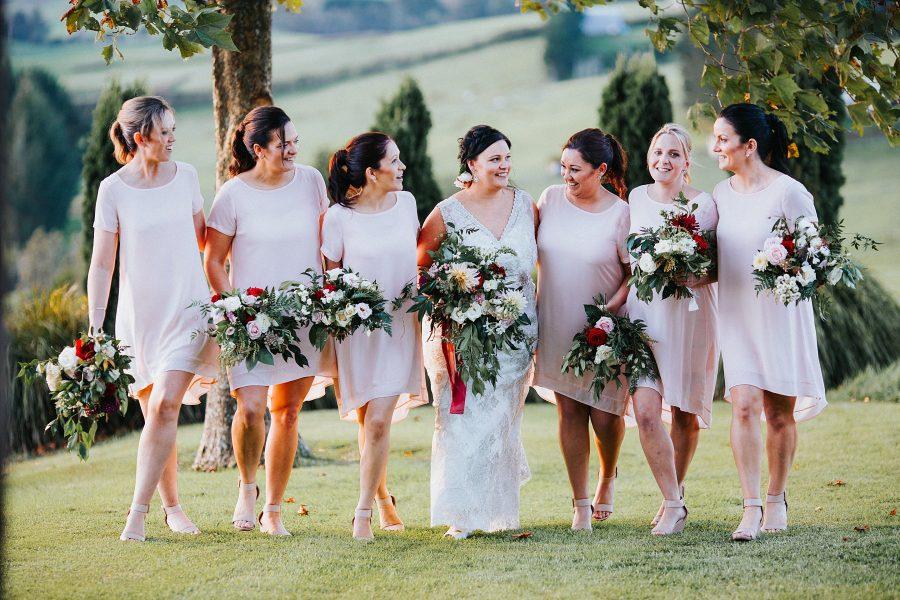 Girls squad pink laughing bridesmaids