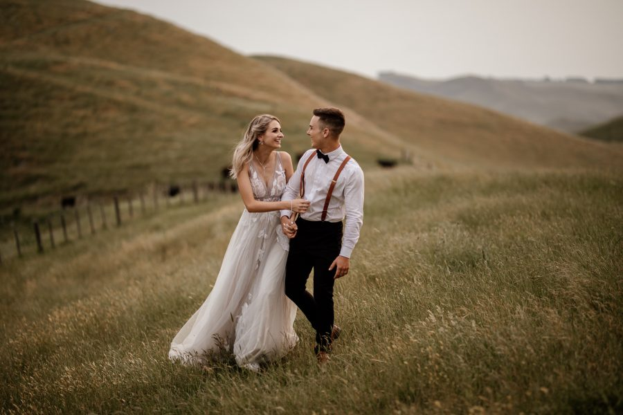 Hawkes Bay Waiterenui Wedding Venue photos of couple laughing in hills
