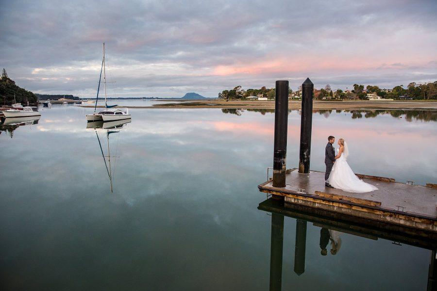 Omokoroa Wedding with beautiful wedding dress and Grooms grey suit