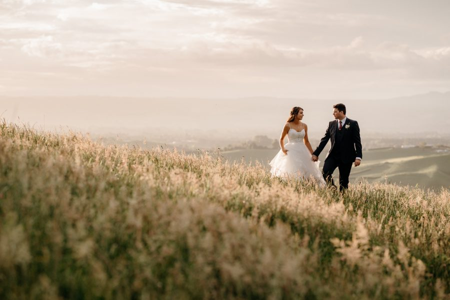 Golden hour country wedding of couple in hills