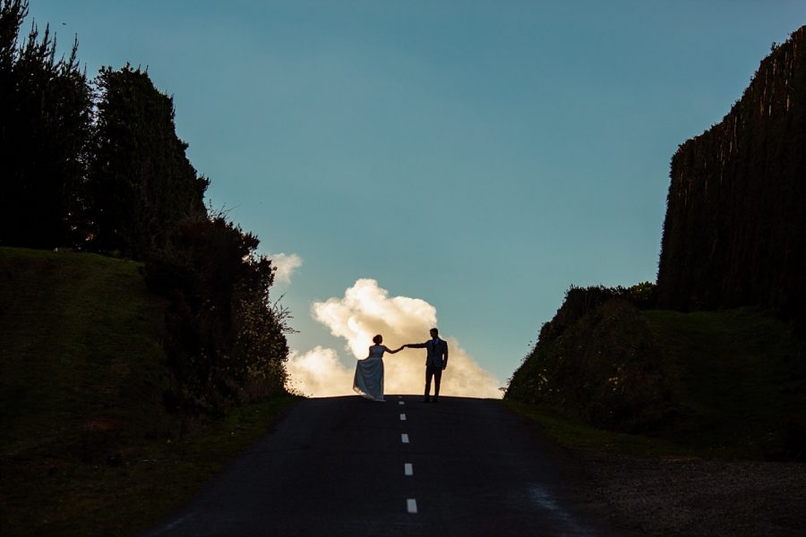 New Zealand Elopement couple cloud top of road