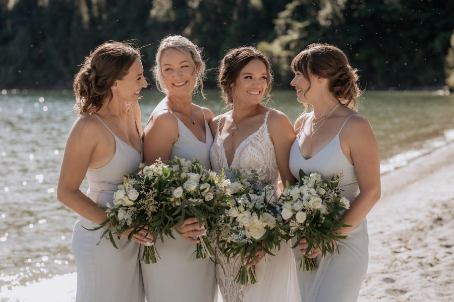 Beautiful boho lace bride with her bridesmaids