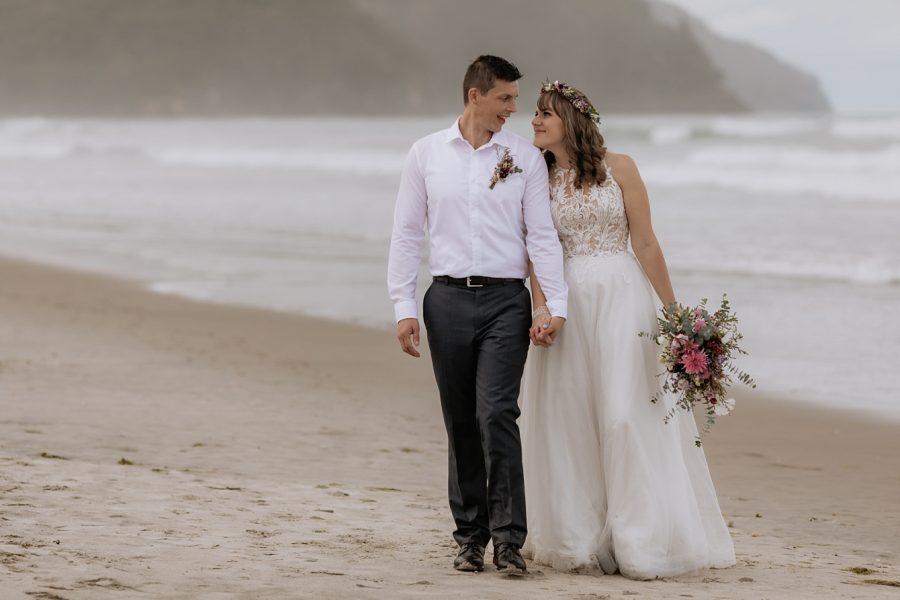 Bride and Groom walking Waihi Beach