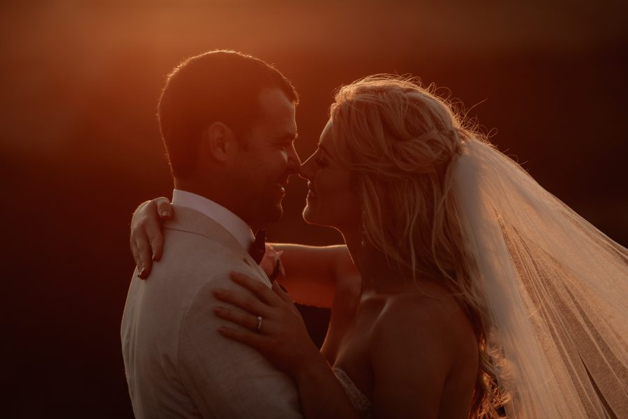 Bride and Groom kissing in golden light