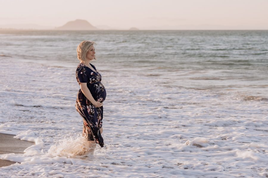 Maternity photos of pregnant Mum standing in the moving sea waters