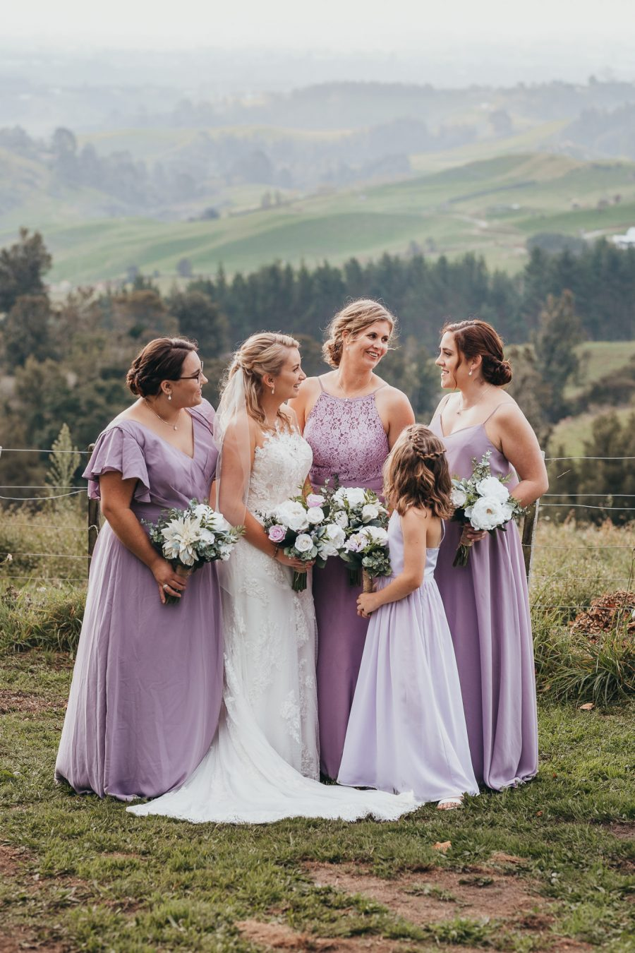Bride with her bridesmaids in lavender