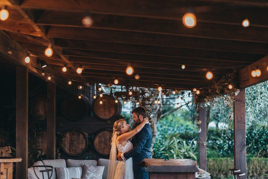 Fairy lights evening shot of bride and groom