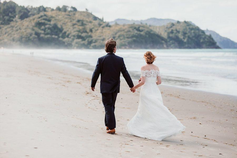 Walking on the beach flat white cafe wedding