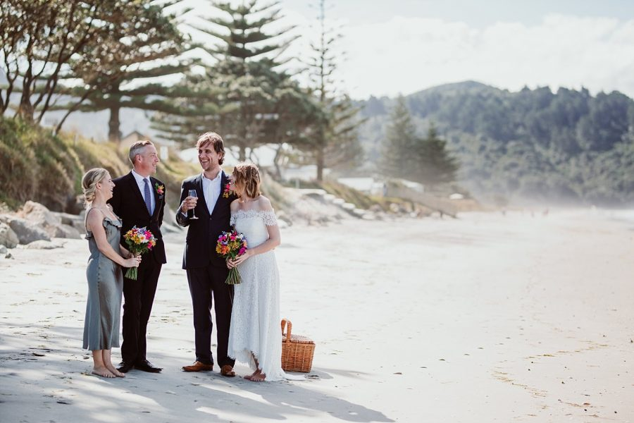 Wedding party in sage green on Waihi beach