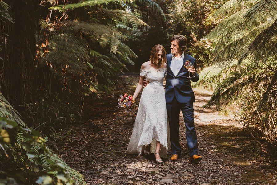 Natural moment betwen bride and groom in the bush at Waihi wedding