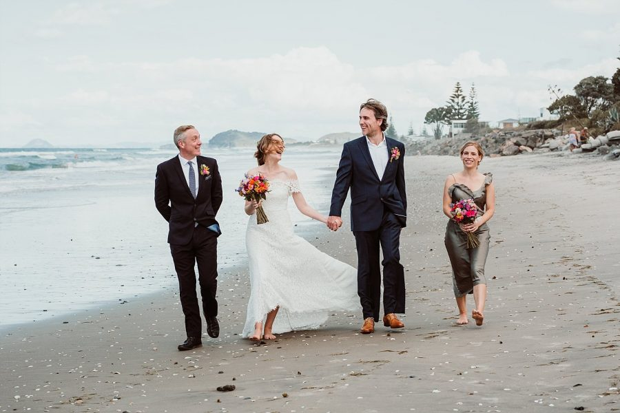 Laughter on the beach Waihi wedding