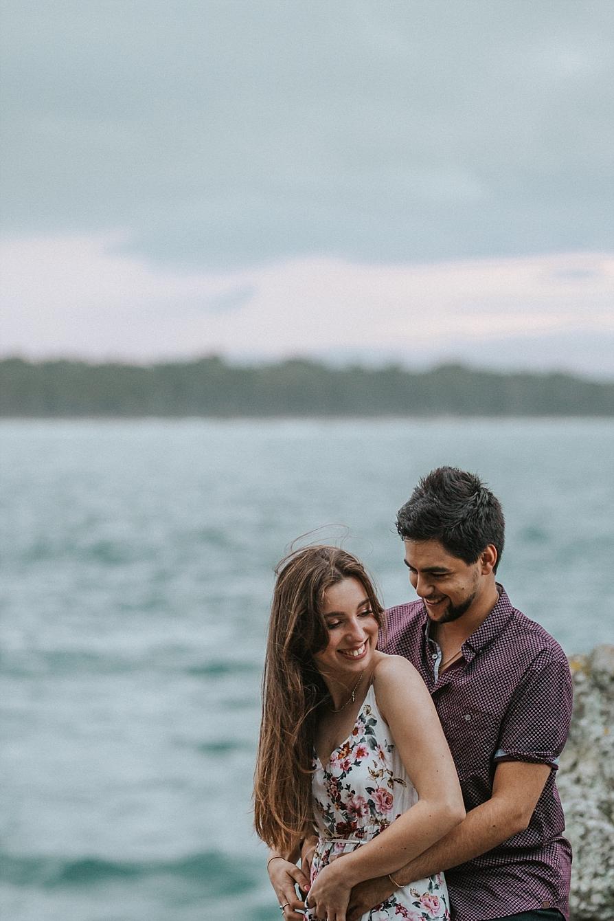 candid shot of engaged couple