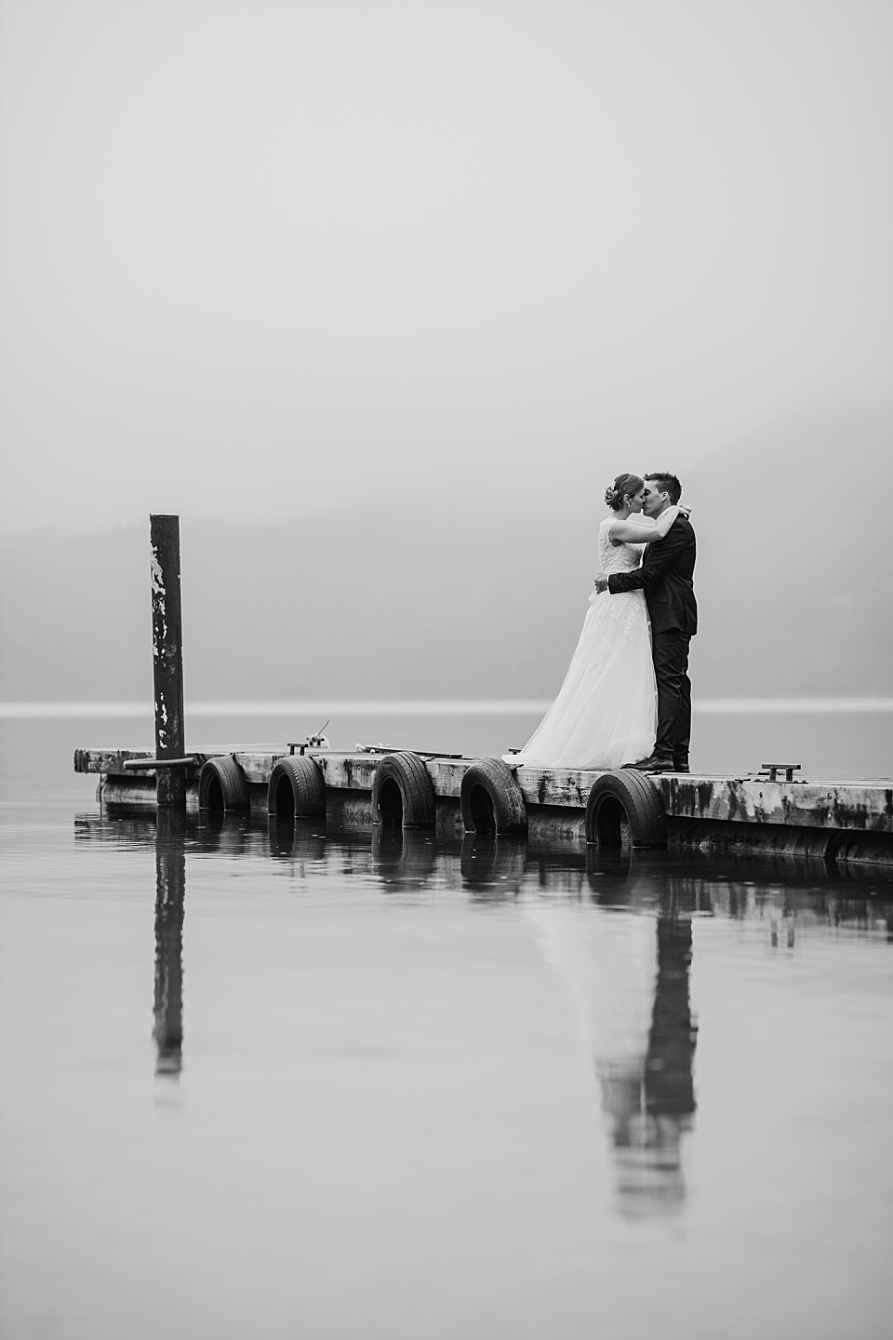 Kissing photo at Lake Okataina Bride and Groom