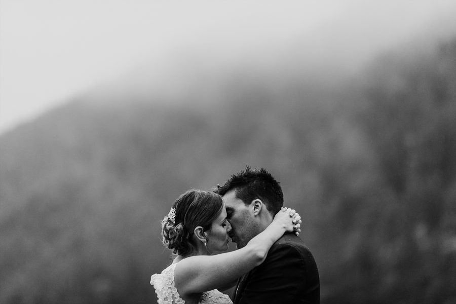 Kissing in the rain on wedding day