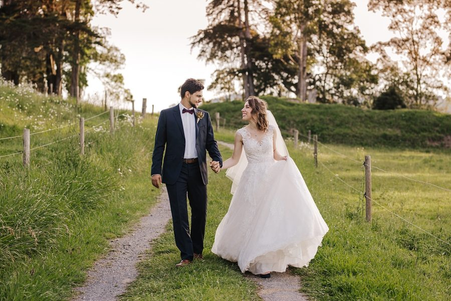Relaxed wedding couple in country setting