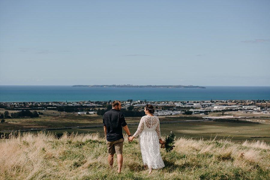 Papamoa Hills overlooking the sea for wedding photos by Pure Images Photograpphy