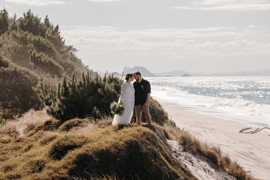 Wedding couple by the forest with Mauao by the beach