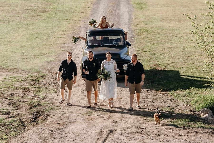 Vintage truck with bridal party and puppy