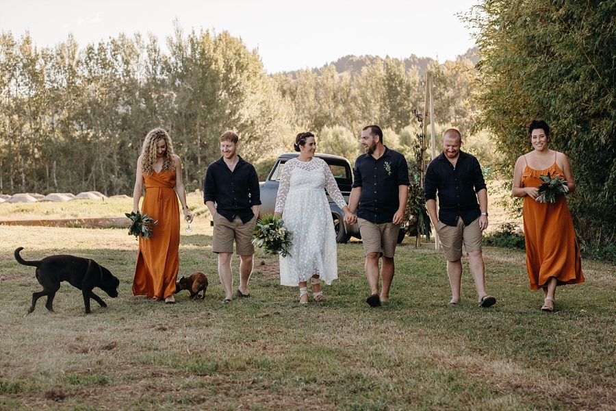 Country rustic wedding party walking with pets