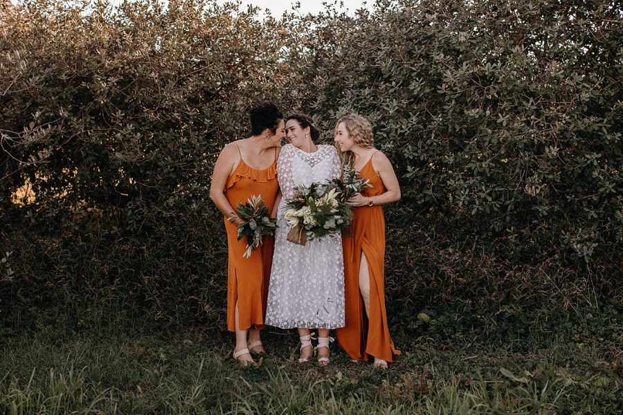 Burnt orange bridesmaids with boho Bride