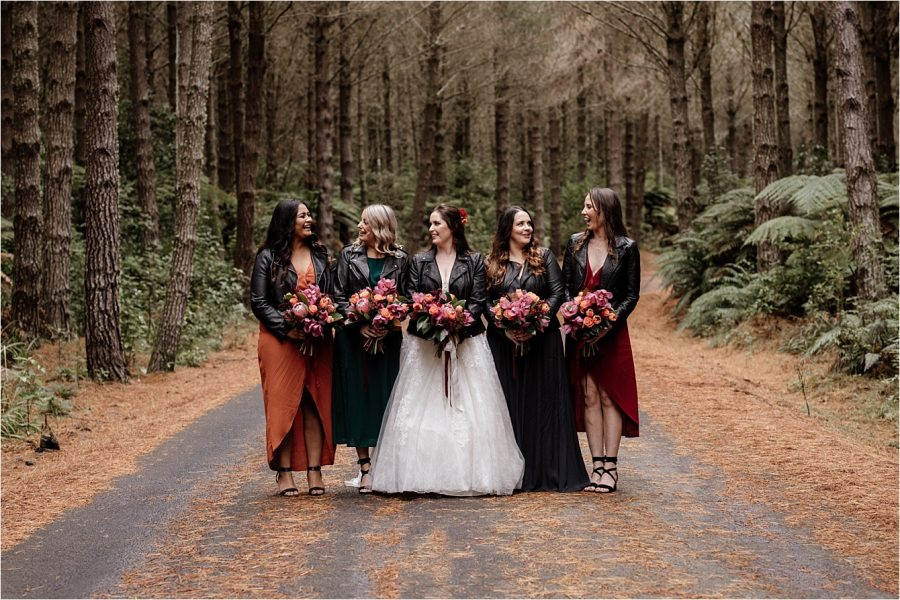 Bridal party bridesmaids Autumn colours in the woods