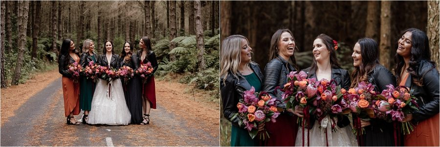 Wine, green, rust, and navy bridesmaids with leather jackets walking in forest in Rotorua