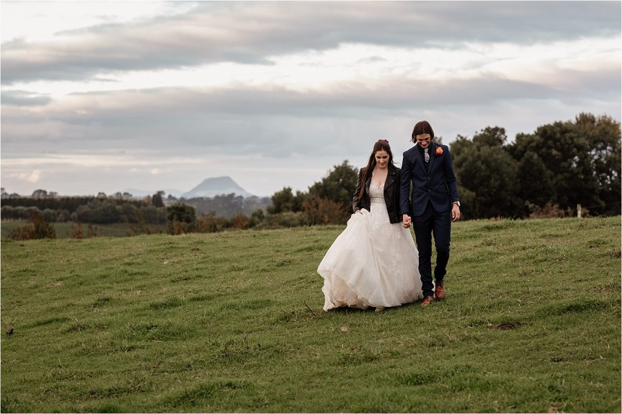 Walking in the country wedding photography Mount Maunganui views