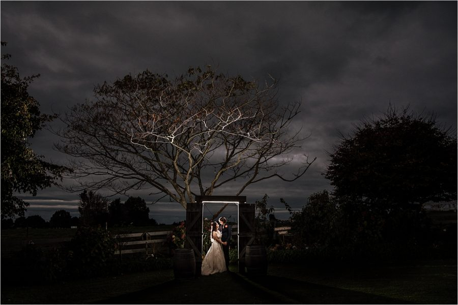 Photos under the wedding doors stand archway