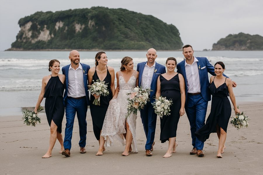 Happy wedding party on Coromandel Beach