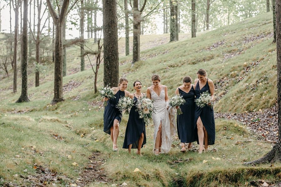 Bride with bridesmaids walking in the country wedding