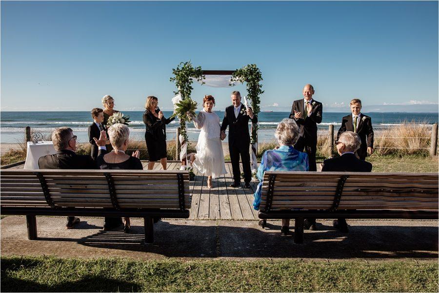 We're married happy bride and groom at Hart Street Beach wedding