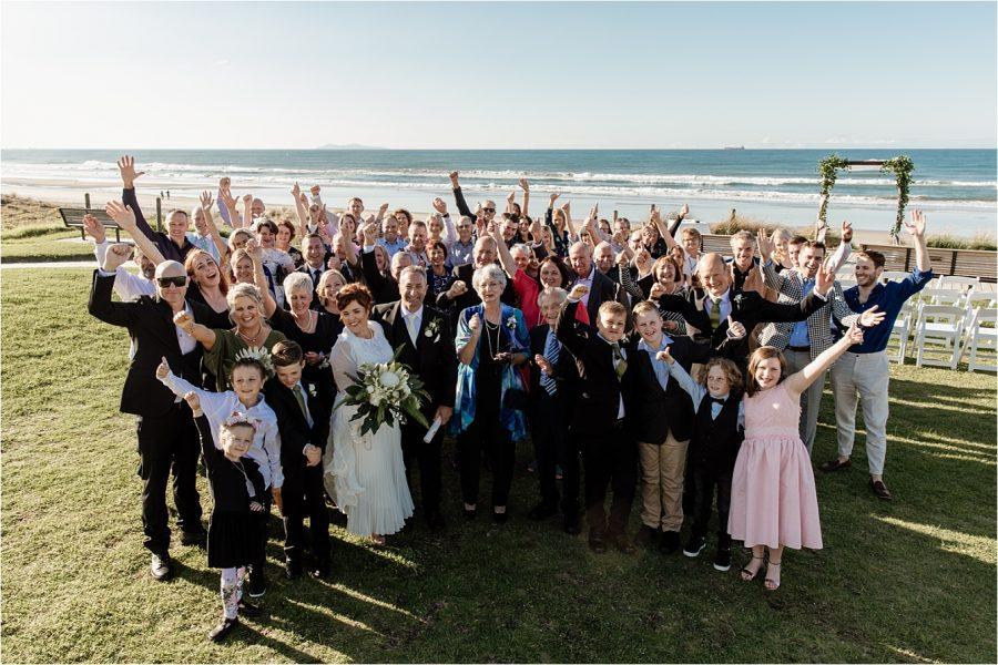 Happy wedding guests Mount Maunganui Beach wedding