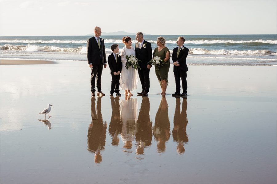 Rustic country sage green wedding party on beach at Hart Street