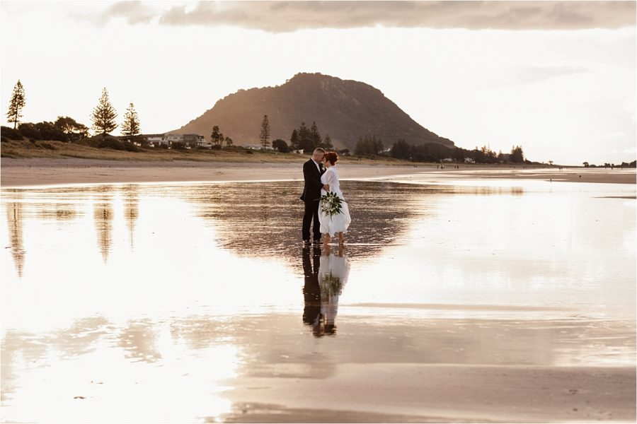 Wedding photos on Mount Maunganui beach by Pure Images Photography