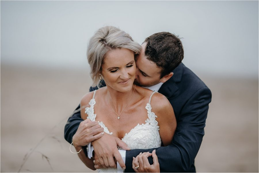 Natural intimate moments wedding couple