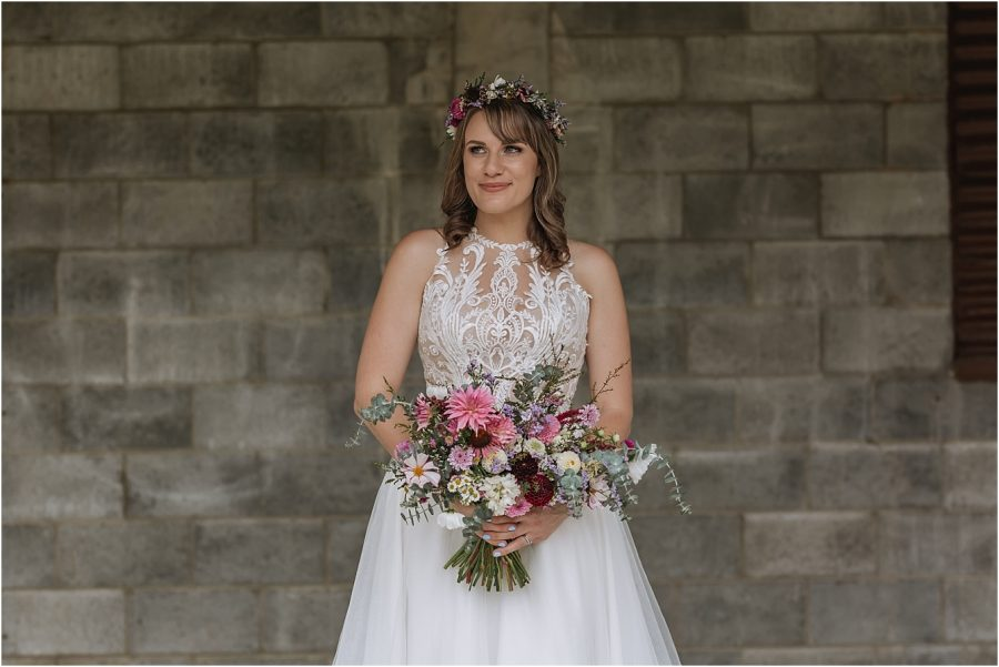 Happy bride with floral bouquet