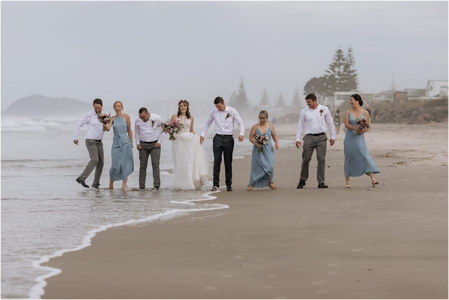 Waves at the beach with wedding party