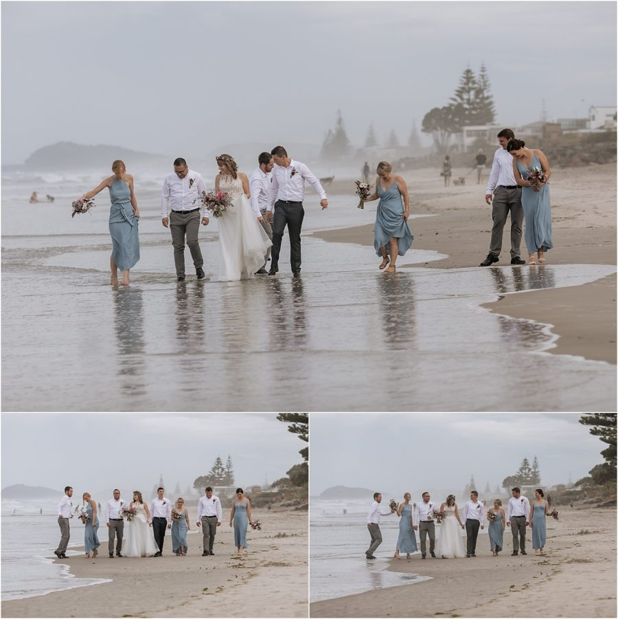 Playing on the beach wedding party