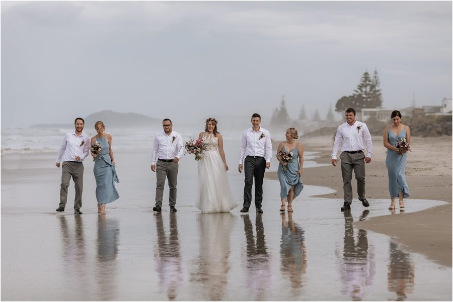 Wedding party walking Waihi Beach