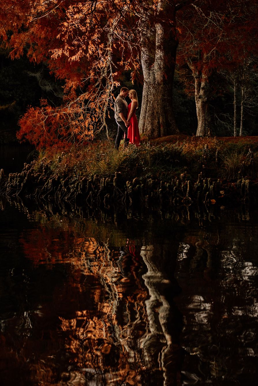 couple by lake in autumn light