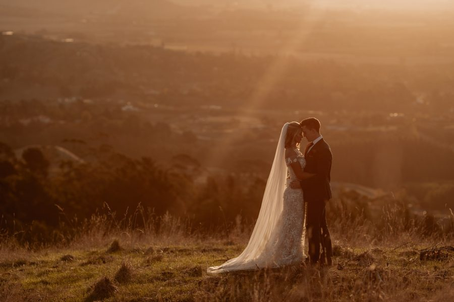 sunset elopement photography of bride and groom