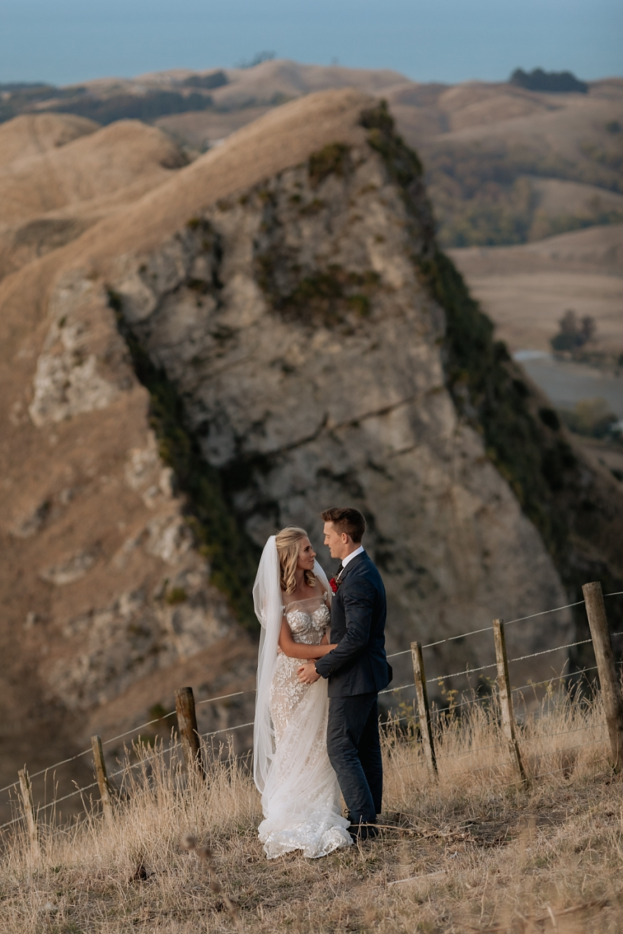 Hawkes Bay elopement photo of cliffs in background