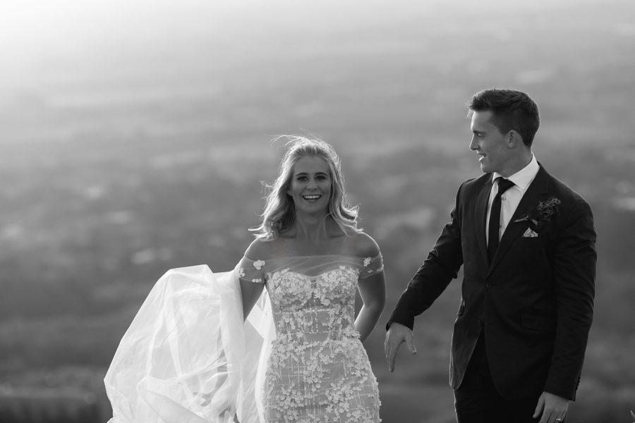 Happy walking capture of elopement couple