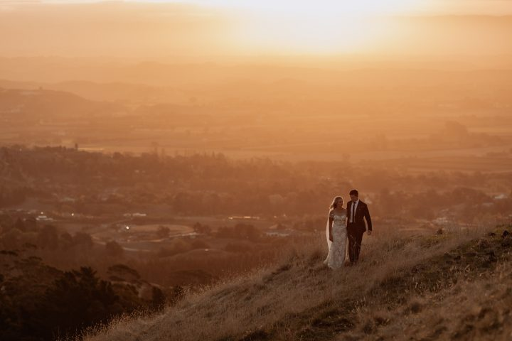 Golden hour elopement photo at Te Mata peak with Pure Images Photography