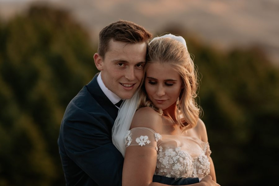 Moody golden hour photo of bride and groom