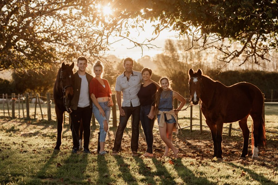 Napier family photo with horses at sunset