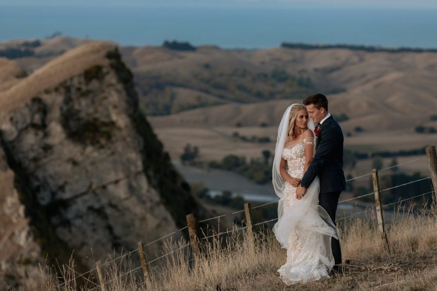 Cliff top wedding pictures with Hawkes Bay views