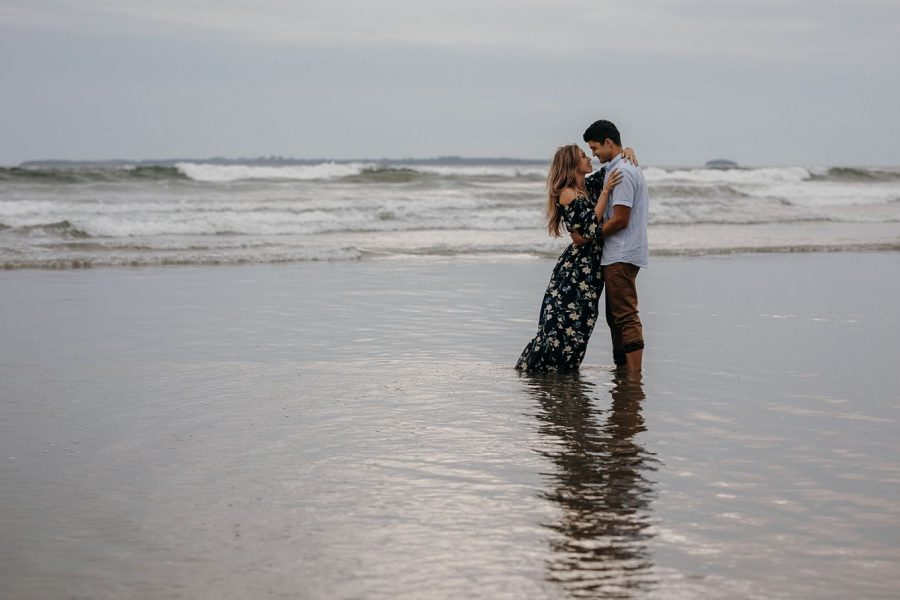 romantic moment in water during couple shoot at Papamoa beach